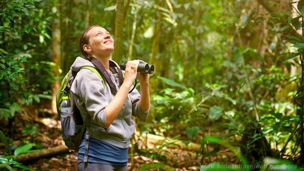 Woman using binoculars for bird watching